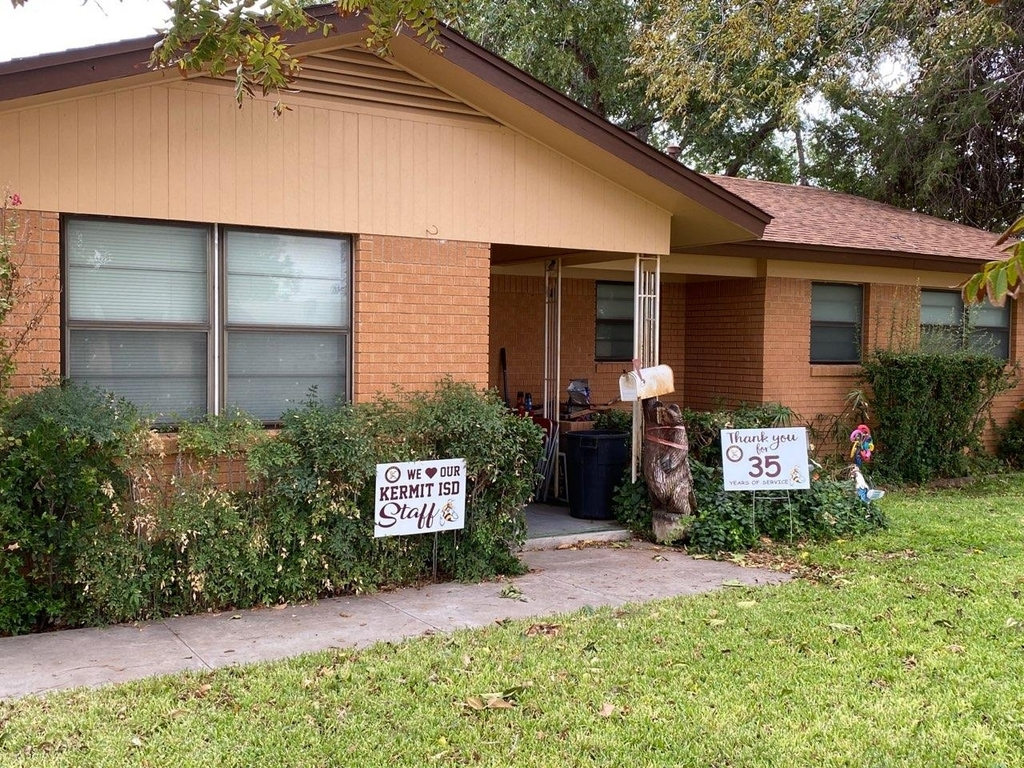 house with yard signs